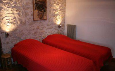 Chambre au premier étage avec deux lits jumeaux